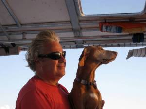 Mike and Belle share a moment at the helm.