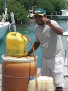 Carlos smiles despite the sludge in our fuel.