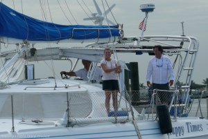 Couple plus one aboard catamaran